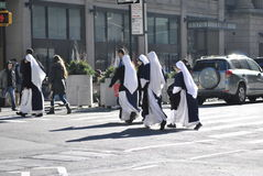 Nuns crossing the street in new york city Stock Photo