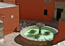 Nuns and fountain, Sta Catalina Monastery, Arequip Royalty Free Stock Photos