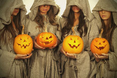 Nuns with halloween pumpkins Stock Photos