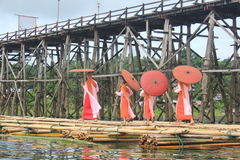 Nuns at the Mon Bridge. Mon nuns walking on the bridge alms round. Sagklaburi at Amphur Kanchanaburi, Thailand Royalty Free Stock Images