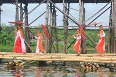 Nuns at the Mon Bridge. Mon nuns walking on the bridge alms round. Sagklaburi at Amphur Kanchanaburi, Thailand Stock Image