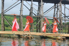 Nuns at the Mon Bridge. Mon nuns walking on the bridge alms round. Sagklaburi at Amphur Kanchanaburi, Thailand Stock Photos