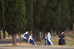 Nuns and monks in the sun on the Appian Way, Rome royalty free stock image