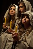 Nuns praing with candles Royalty Free Stock Images