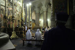 Nuns praying in the Church of the Holy Sepulchre in Jerusalem. Early in the morning before the arrival of pilgrims from around the world, nuns praying in the Stock Photo