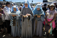 Nuns praying at the Sanctuary of Fatima during the celebrations of the apparition of the Virgin Mary in Fatima, Portugal. Fatima, Portugal - May 13, 2014: Nuns stock photos