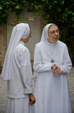 Nuns. Two Nuns enjoying the street in the middle of an Italian festival in Sirmione village. Photo taken on Sep,2013 stock photography
