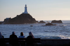 Nuns and visitors at Corbier Lighthouse, Jersey. At sunset Royalty Free Stock Photography