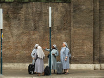 Nuns waiting for the bus in Rome Stock Photos