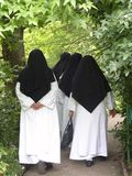 Nuns walking. Through monets garden giverny normandy france royalty free stock images