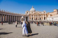 Nuns walking by St. Peter's square. VATICAN, ITALY - 10 MARCH 2018: nuns walking by St. Peter's square stock photos