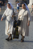 Nuns in white dress stock images