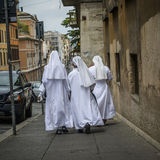 Nuns with white robes Stock Photography
