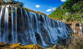 NuoRiLang waterfalls. Wide vast, sun exposure, exceptionally charming Stock Image