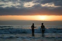 Nuotata di tramonto Immagine Stock
