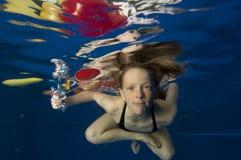Nuoto della bambina subacqueo Fotografia Stock Libera da Diritti