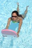 Nuoto della ragazza immagini stock