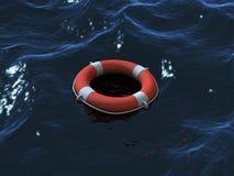 Nuoto di Lifebuoy nelle onde Fotografie Stock