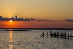 Nuoto di tramonto Fotografia Stock