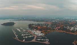Nuottaniemi marina seen from air on a misty autumn day, Espoo Finland. Nuottaniemi marina seen from air on a foggy and moody autumn day, Espoo Finland royalty free stock photos