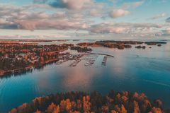 Nuottaniemi marina seen from the sky on an autumn day in Espoo Finland. Nuottaniemi marina with boats on pier and on land being stored, Espoo Finland royalty free stock photography