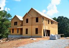 Nuova casa che è costruita Immagine Stock Libera da Diritti