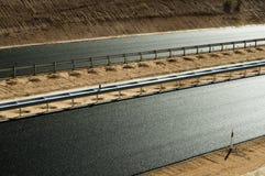 Nuova strada della strada principale dell'asfalto Fotografie Stock
