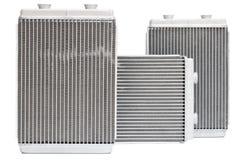 Nuova stufa automobilistica del radiatore tre su un fondo bianco Immagini Stock