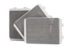 Nuova stufa automobilistica del radiatore tre su un fondo bianco Immagine Stock Libera da Diritti