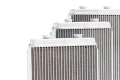 Nuova stufa automobilistica del radiatore tre su un fondo bianco Fotografie Stock Libere da Diritti