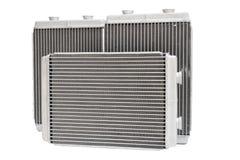 Nuova stufa automobilistica del radiatore tre su un fondo bianco Immagine Stock