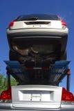 Nuove automobili in transito Immagini Stock