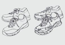 Nuove e vecchie scarpe di addestramento Fotografia Stock