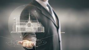 Nuove tecnologie disponibile del punto di riferimento di Notre Dame de Paris Businessman Holding Immagini Stock