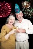 Nuovi anni di partito con i fuochi d'artificio Fotografia Stock Libera da Diritti