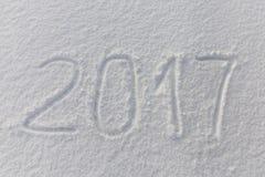 2016 nuovi anni scritti sul fondo bianco della neve Fotografia Stock Libera da Diritti