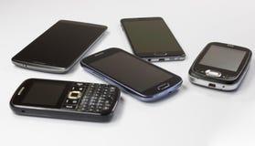 Nuovi e vecchi telefoni mobili Fotografie Stock