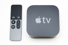 Nuovi media di TV di Apple che scorrono il microconsole del giocatore Immagine Stock