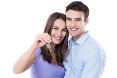 Nuovi proprietari domestici con la chiave Fotografie Stock Libere da Diritti