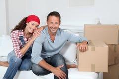 Nuovi proprietari domestici sorridenti Immagine Stock