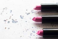 Nuovi rossetti rosa messi, spazio della copia Immagine Stock