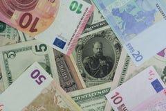 Nuovi soldi dei vecchi soldi, USD, euro fotografia stock libera da diritti