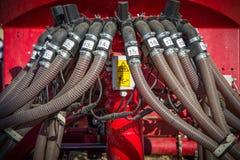 Nuovi trattori del macchinario agricolo ed attrezzature di lavorazione Immagine Stock Libera da Diritti