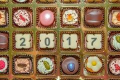 Nuovo anno 2017 dei dolci e delle caramelle del cioccolato Immagine Stock