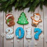 Nuovo anno 2017 del pan di zenzero e Natale, pan di zenzero Santa Claus Fotografie Stock