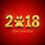 Nuovo anno della cartolina di festa del cane con l'orma della zampa, te dell'oro illustrazione di stock