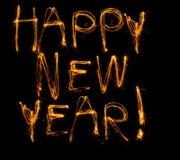 Nuovo anno felice scritto in sparklers Immagini Stock Libere da Diritti