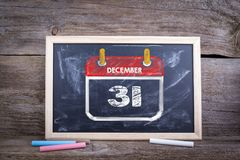 Nuovo anno, il 31 dicembre Fondo del bordo di gesso Fotografie Stock Libere da Diritti