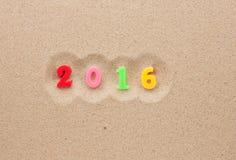 Nuovo anno 2016 scritto nella sabbia Immagine Stock