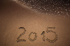 Nuovo anno 2015 scritto in sabbia Fotografia Stock Libera da Diritti